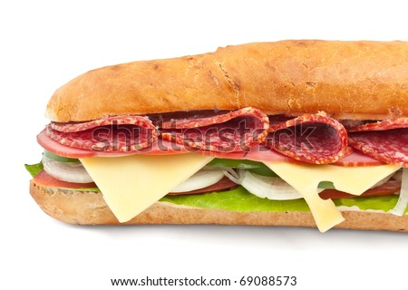 long baguette sandwich with lettuce, vegetables, salami and cheese on white background - stock photo