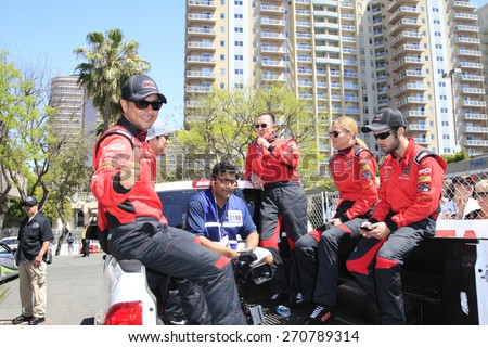 LONG BEACH - APR 18: Raul Mendez, Robert Patrick, Tricia Helfer, Nathan Kress at the Toyota Grand Prix Of Long Beach Pro/Celebrity Race - Race Day on April 18, 2015 in Long Beach, California - stock photo