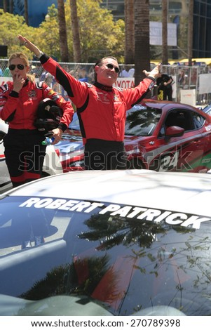 LONG BEACH - APR 18: Tricia Helfer, Robert Patrick at the Toyota Grand Prix Of Long Beach Pro/Celebrity Race - Race Day on April 18, 2015 in Long Beach, California - stock photo