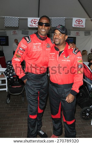 LONG BEACH - APR 18: Willie Gault, Alfonso Ribeiro at the Toyota Grand Prix Of Long Beach Pro/Celebrity Race - Race Day on April 18, 2015 in Long Beach, California - stock photo