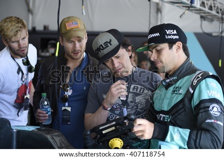 LONG BEACH, CA - APRIL 2:   Actors Austin Stilwell, Glen Powell and Clifton Collins Jr.get a VIP tour of  Nelson Piquet Jr.'s garage at the FIA Formula  E Prix April 2, 2016 in Long Beach, CA.