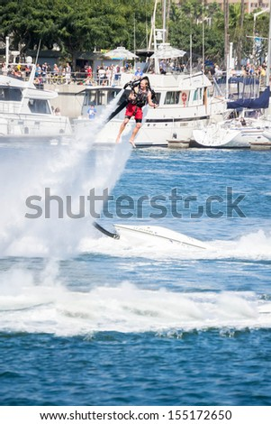 LONG BEACH, CA - September 21: Unidentfied man demonstrates flyboard acrobatics in Long Beach on September 21, 2013, in Long Beach, CA