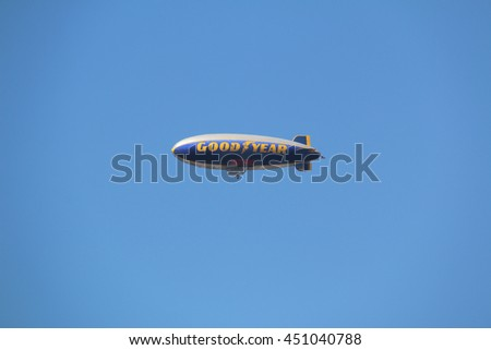 Long Beach, CA, USA - March 16, 2016: Goodyear Blimp, airship operated by the Goodyear Tire and Rubber Company, is used for advertisement and capturing aerial views of live sporting events on TV. - stock photo
