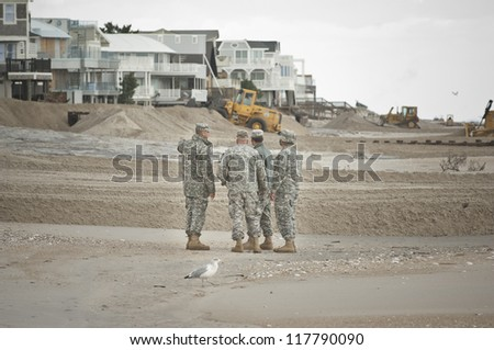 LONG BEACH ISLAND,NJ-NOVEMBER 1: Members of the NJ National Guard beginning their assessment of the damage to Long Beach Island in the wake of Hurricane Sandy.Nov 1 2012, Long Beach Island, NJ - stock photo