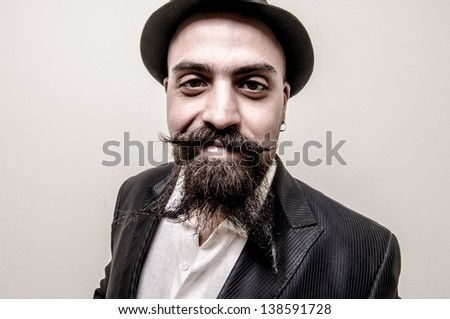 long beard and mustache hipster with elegant suit - stock photo