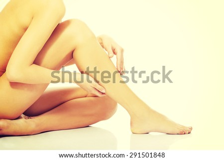 Long beautiful fit woman legs - stock photo