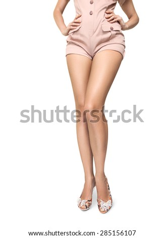 Long beautiful legs of young woman isolated on white background