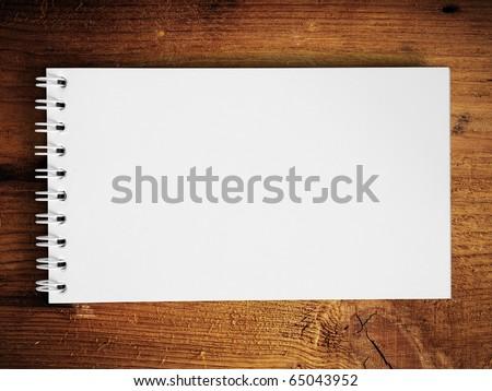 Long blank white note book horizontal on teak wood background - stock photo