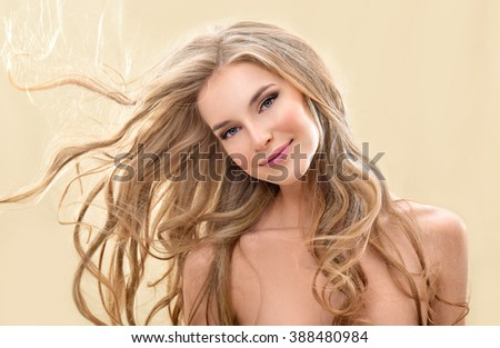 Long blond Hair.  Beauty Model Girl with Luxurious Hair. - stock photo