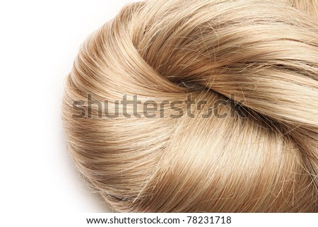 long blond human hair on white background