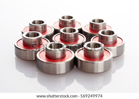 skateboard bearing spacer. long board skateboard bearings with built-in spacers on a white background. ?lipping bearing spacer l