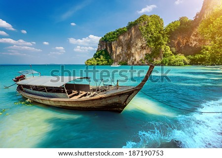 Long boat and rocks. Railay beach in Krabi, Thailand
