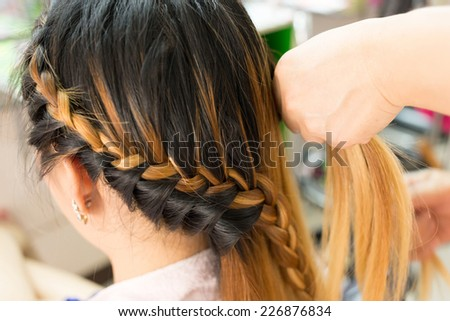 long braid creative brown hair style in salon beauty - stock photo