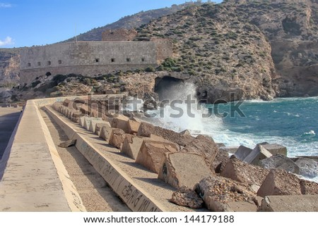 long breakwater at the entrance to the port of Cartagena Spain - stock photo