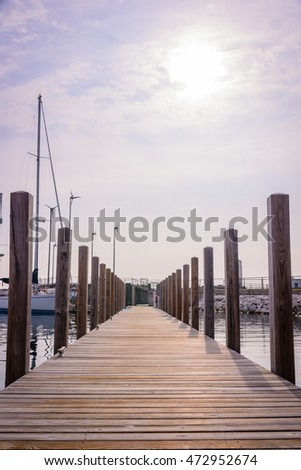 Long bridge with yachts in the sea / Warm tone.