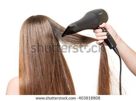 Long brown hair, and hair dryer in a hand isolated on white background. - stock photo