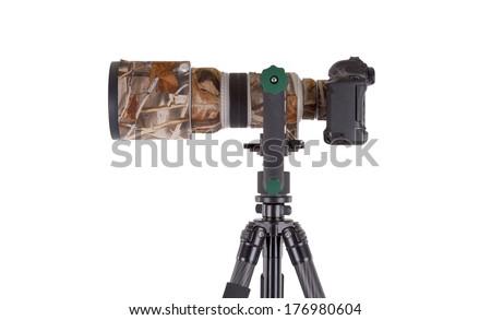 Long camouflaged professional supertele on tripod isolated on white - stock photo