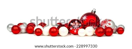 Long Christmas border of red and white ornaments over a white background - stock photo