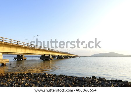 Long concrete bridge for main road over lake:select focus with shallow depth of field. - stock photo