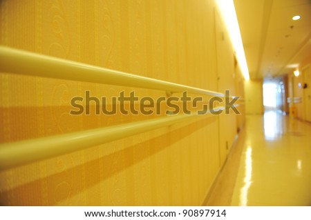 long corridor in  hospital with hand rail.