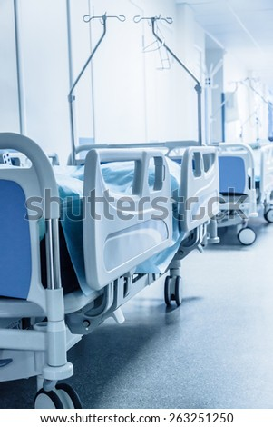 Long corridor in hospital with surgical beds. Tinted picture - stock photo