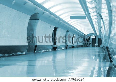 Long corridor in metro station - stock photo