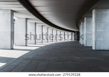 long corridor of a building with columns, monochrome background - stock photo