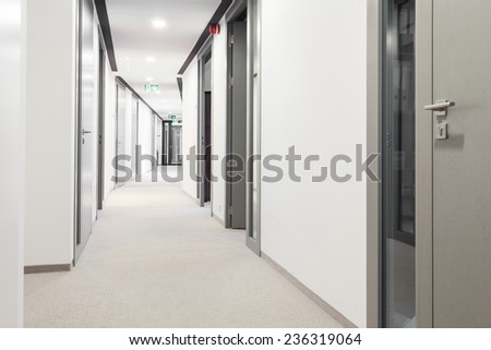 Long corridor with a lot of doors - stock photo