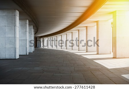 long corridor with columns at sunset. urban  - stock photo