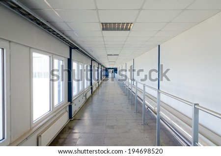 Long corridor with door at end. - stock photo