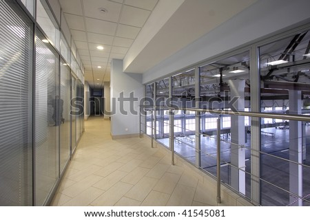 Long corridor with glass walls in style hi-tech