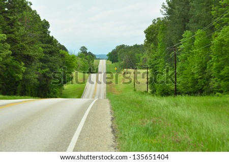 Long Country Road - stock photo