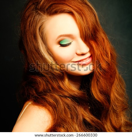Long Curly Red Hair. Fashion Woman Portrait. Beauty Model Girl with Wavy Hair - stock photo