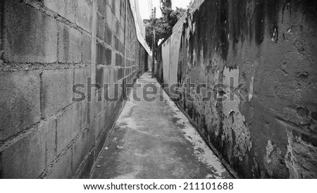 Long Dark Empty Inner City Alleyway Background - stock photo