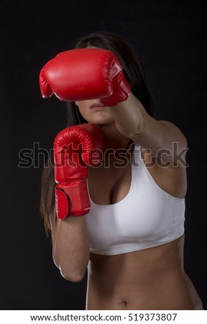 Long dark hair hair girl with red box gloves on her hands