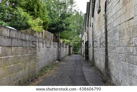 Long Dark Inner City Alley - stock photo