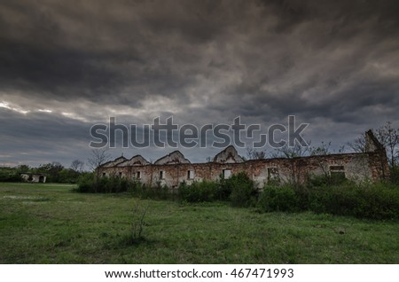 long Destroyed house with rain clouds