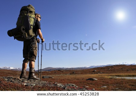long distance hiker with backpack in Sweden