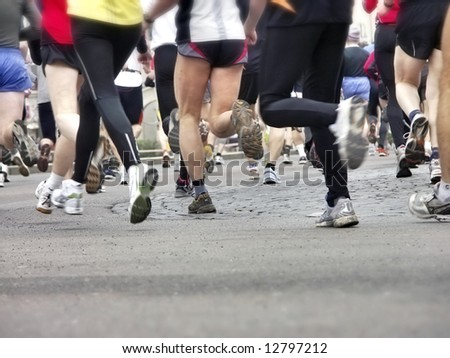 Long distance runners in closeup, shallow focus - stock photo