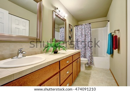Long double sink bathroom vanity with drawers and two mirrors. Northwest, USA
