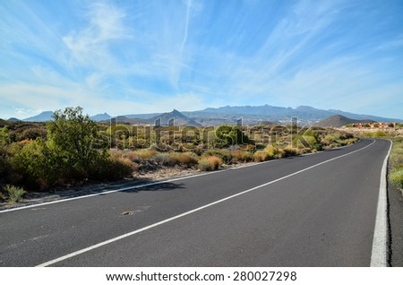 Long Empty Desert Asphalt Road in Canary Islands Spain - stock photo
