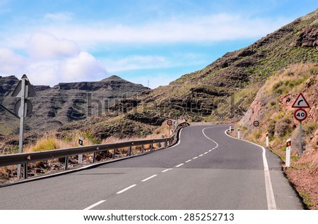 Long Empty Desert Asphalt Road in Canary Islands Spain