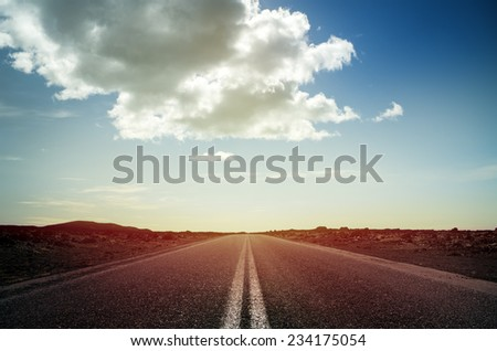 Long endless road with no traffic - stock photo