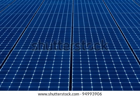 long endless row of blue solar panels to produce electricity - stock photo