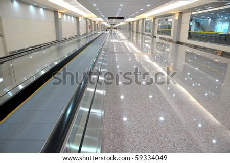 Long escalator for easy transport of people and goods. - stock photo
