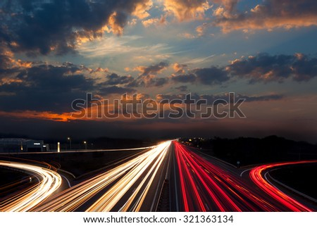 Long Exposure abstract urban background - Speed Traffic - light trails on motorway highway at night, fantastic sky - stock photo