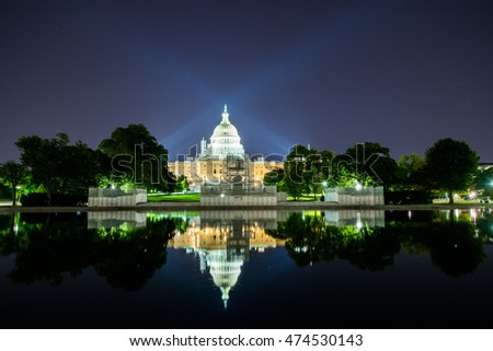 Long Exposure at Night of the United States Capitol with reflection off Water