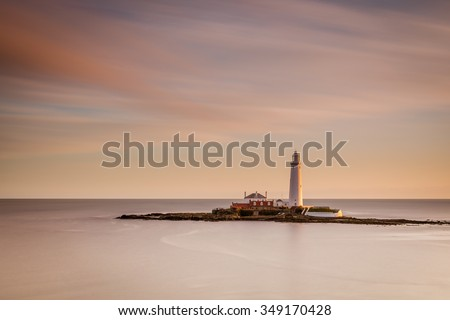 Long Exposure at St Mary's Lighthouse / St Mary's Lighthouse on a tiny island just north of Whitley Bay on the coast of North East England. At low tide a causeway allows access - stock photo