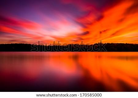 Long exposure at sunset, at Long Arm Reservoir, near Hanover, Pennsylvania. - stock photo