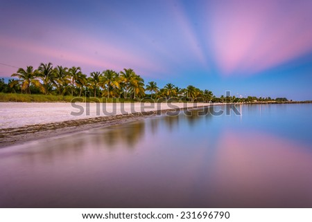 Long exposure at sunset of Smathers Beach, Key West, Florida. - stock photo